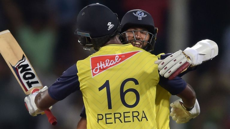 Thisara Perera and Hashim Amla celebrate the World XI's victory in the second T20