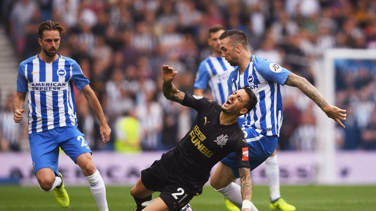 Joselu is challenged by Shane Duffy in the first half