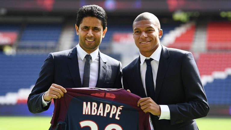 Kylian Mbappe (right) together with Paris Saint Germain's Qatari president Nasser Al-Khelaifi