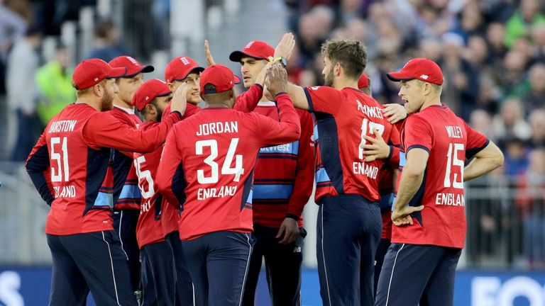 England celebrate after Plunkett (second right) runs out Chris Gayle at Chester-le-Street