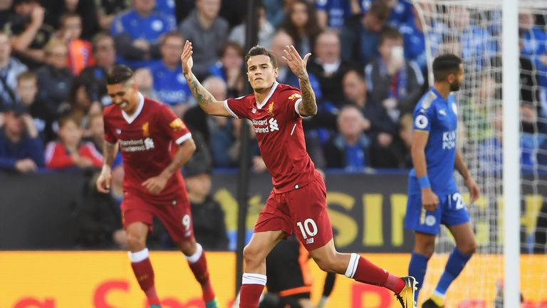 Philippe Coutinho celebrates after his free-kick put Liverpool 2-0 ahead