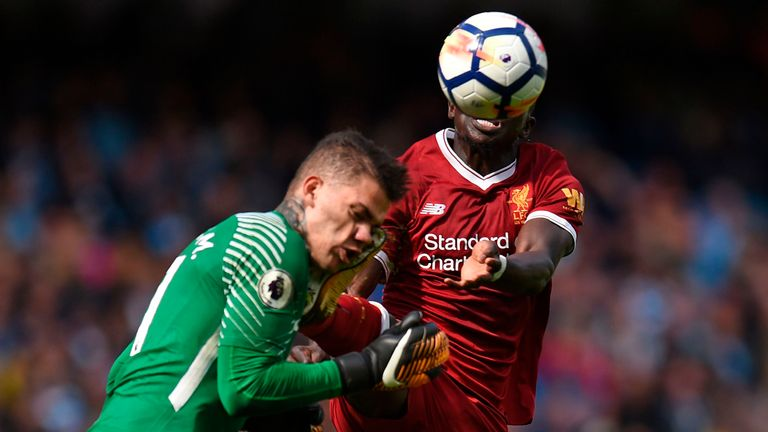Sadio Mane (right) was sent off in the reverse fixture after catching Man City 'keeper Ederson with his boot