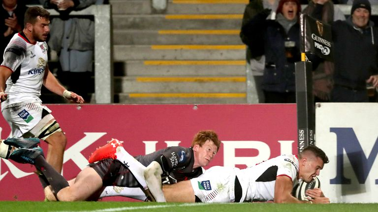 Rhys Patchell cannot prevent Jacob Stockdale from scoring a try