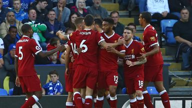 Mohamed Salah is mobbed by his team-mates after opening the scoring against Leicester