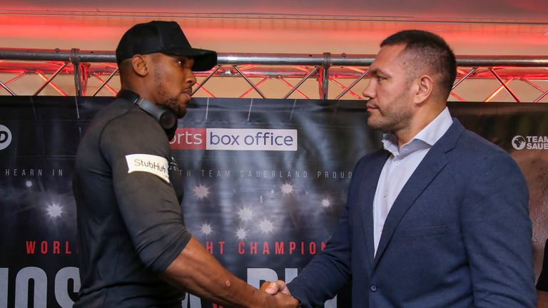 Britain's Anthony Joshua (L) and Bulgaria's Kubrat Pulev (R) shake hands during a press conference at the Principality Stadium in Cardiff on September 11,