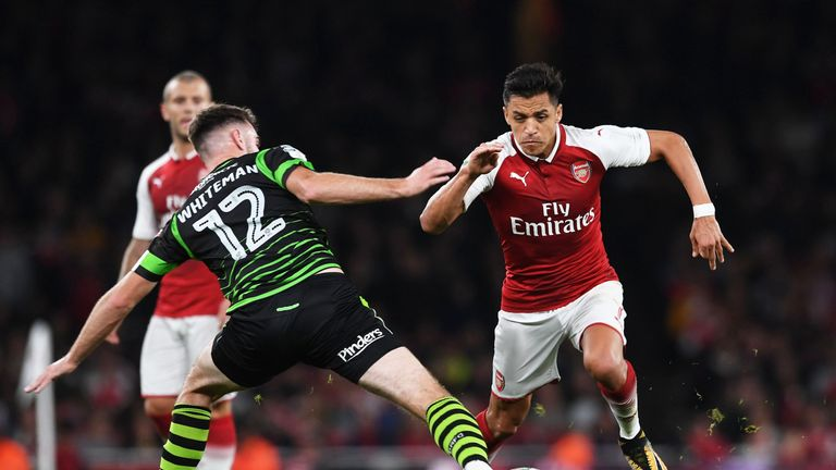 Alexis Sanchez of Arsenal takes on Ben Whiteman during the Carabao Cup match against Doncaster Rovers