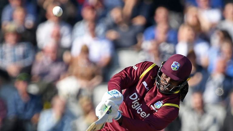 Chris Gayle plays a shot during the first ODI between England and the Windies at Old Trafford