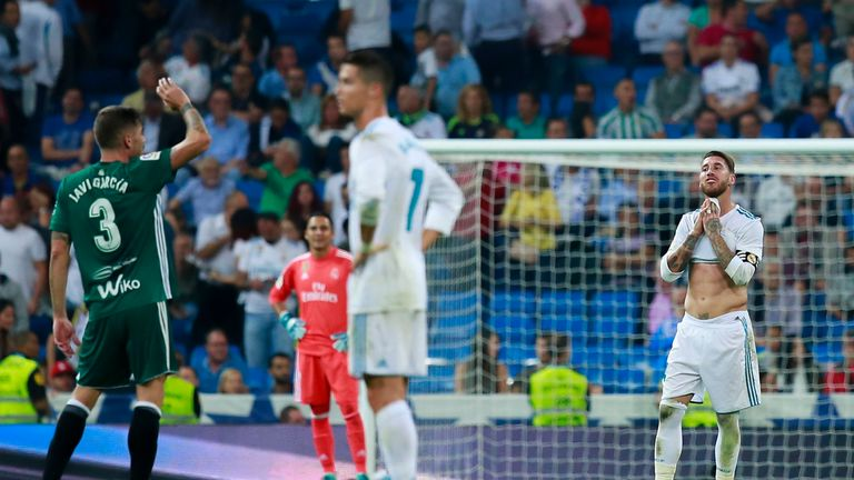 MADRID, SPAIN - SEPTEMBER 20: Sergio Ramos (R) of Real Madrid CF recats as Real Betis Balompie players celebrate their first goal during the La Liga match