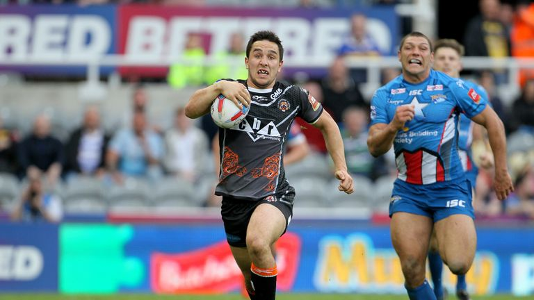 Castleford's Tom Holmes runs the length of the pitch to score a try during day two of the Betfred Super League Magic Weekend at St James' Park, Newcastle