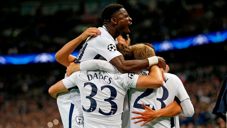 Tottenham players celebrate the opening goal during the UEFA Champions League Group H football match between Tottenham Hotspur and Borussia Dortmund at Wem