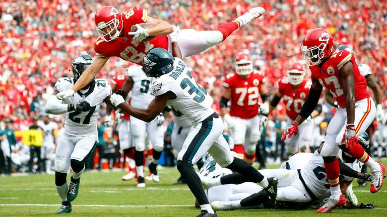 Travis Kelce leaps for a TD