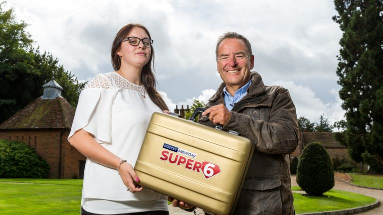 Our first Super 6 millionaire Grace Berry receives her winnings from Soccer Saturday host Jeff Stelling