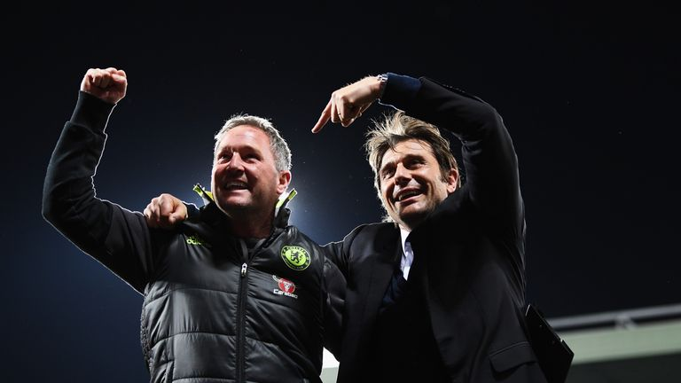 Steve Holland (left) celebrate Chelsea's 2016/17 Premier League title with boss Antonio Conte