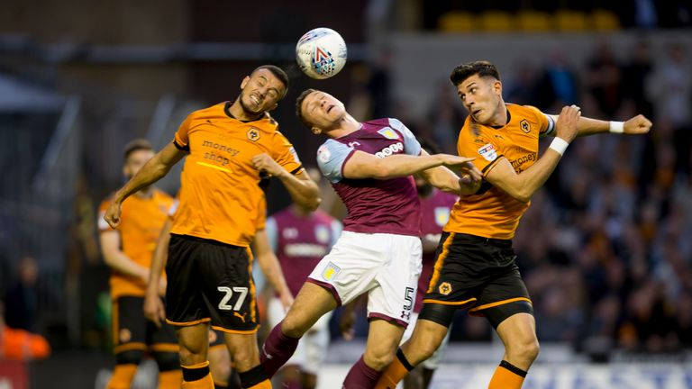 Aston Villa's James Chester comes under heavy pressure during the defeat to Wolves