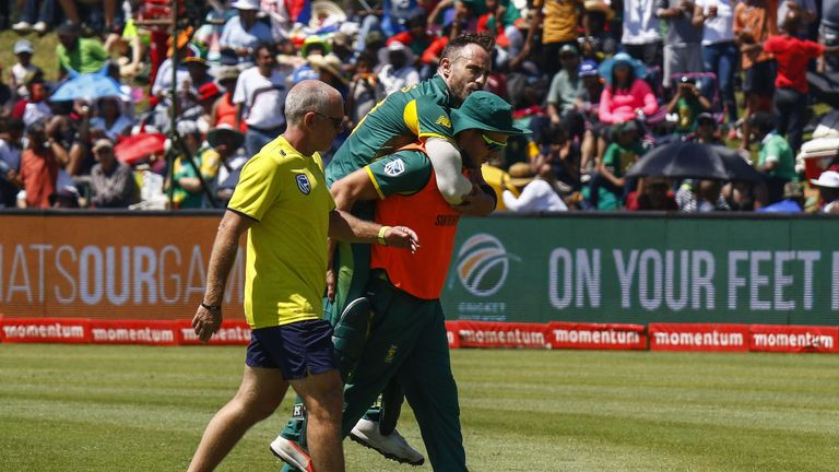 Faf du Plessis - being piggybacked off the field by David Miller -  will miss the tournament with a stress fracture of the back