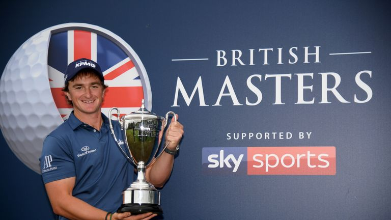 Paul Dunne proudly displays the trophy after winning the British Masters supported by Sky Sports