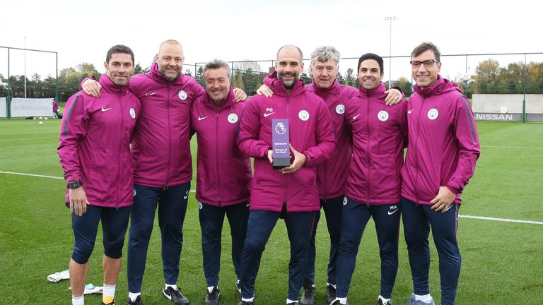 Pep Guardiola and his coaching staff pose with the Manager of the Month Award for September 2017