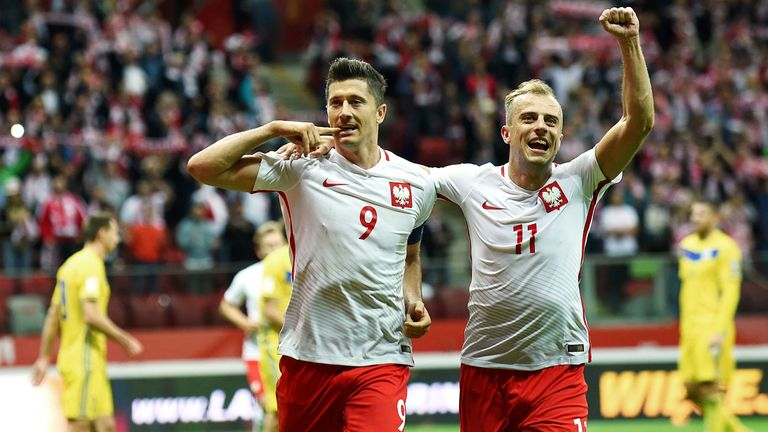 Merson has tipped Poland striker Robert Lewandowski (left) to be a contender for tip scorer in the tournament