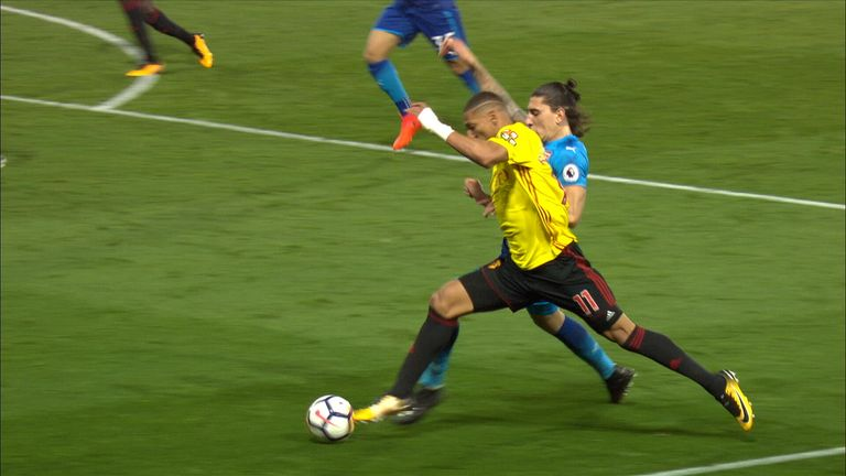 Hector Bellerin is adjudged to have fouled Richarlison