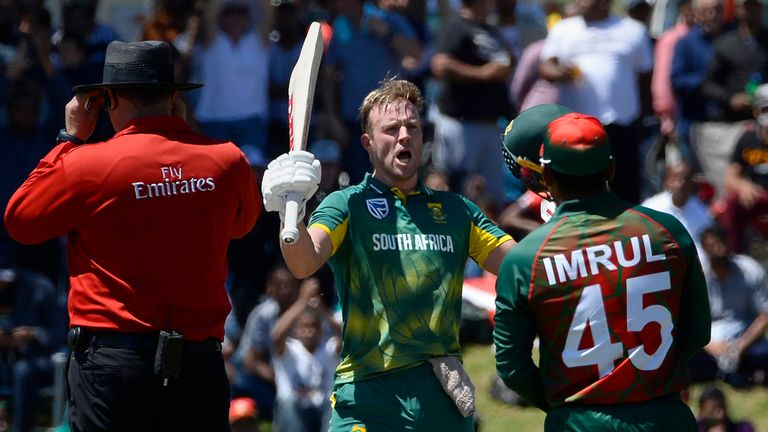 South Africa's AB de Villiers (C) celebrates after scoring a century (100 runs) during the second one day international (ODI) cricket