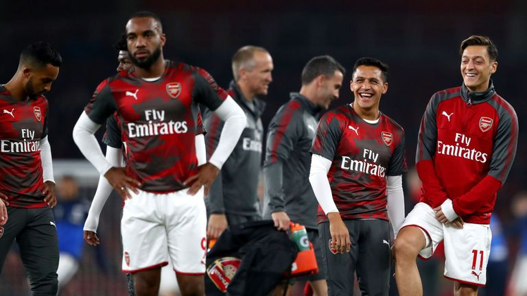 LONDON, ENGLAND - SEPTEMBER 25:  Alexis Sanchez and Mesut Ozil of Arsenal share a joke prior to the Premier League match between Arsenal and West Bromwich