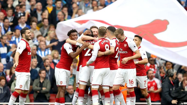 LONDON, ENGLAND - OCTOBER 01: Nacho Monreal of Arsenal celebrates scoring his sides first goal with his Arsenal team mates during the Premier League match