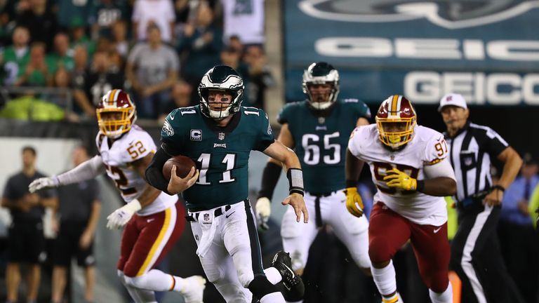 PHILADELPHIA, PA - OCTOBER 23:  Carson Wentz #11 of the Philadelphia Eagles runs with the ball against the Washington Redskins during their game at Lincoln