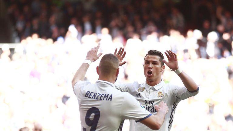 MADRID, SPAIN - APRIL 02:  Karim Benzema (L) of Real Madrid CF celebrates scoring their opening goal with teammate Cristiano Ronaldo (R) during the La Liga