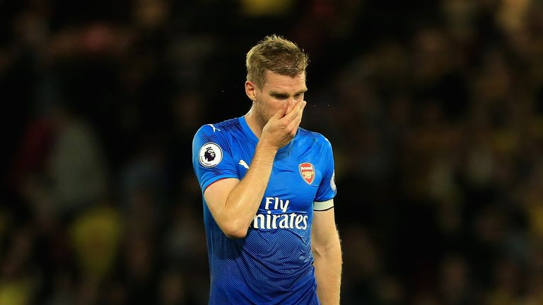 WATFORD, ENGLAND - OCTOBER 14:  Per Mertesacker of Arsenal looks dejected in defence the Premier League match between Watford and Arsenal at Vicarage Road