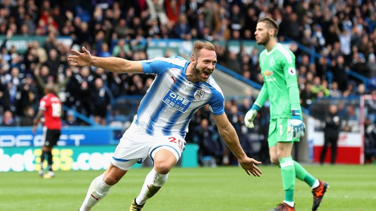 HUDDERSFIELD, ENGLAND - OCTOBER 21:  Laurent Depoitre of Huddersfield Town celebrates as he scores their second goal during the Premier League match betwee