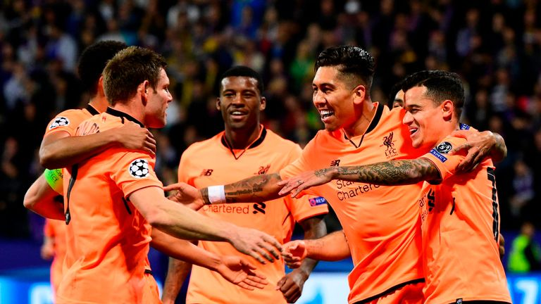 Liverpool's Brazilian forward Roberto Firmino (2nd R)  celebrates with teammates after scoring a goal during the UEFA Champions League group E football mat