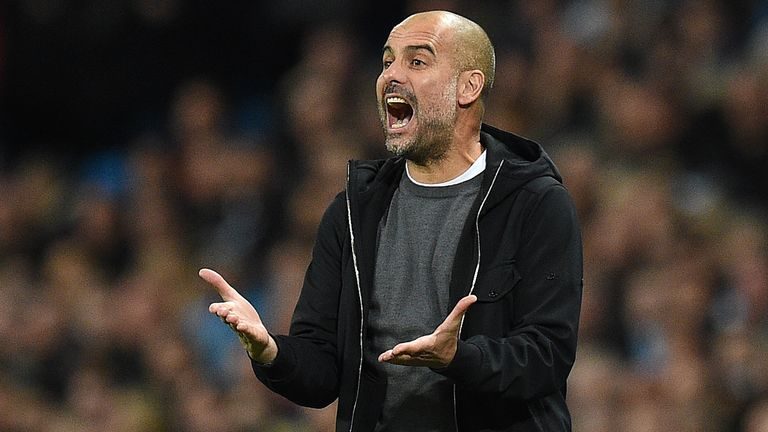 Manchester City's Spanish manager Pep Guardiola shouts instructions to his players from the touchline during the UEFA Champions League Group F football mat
