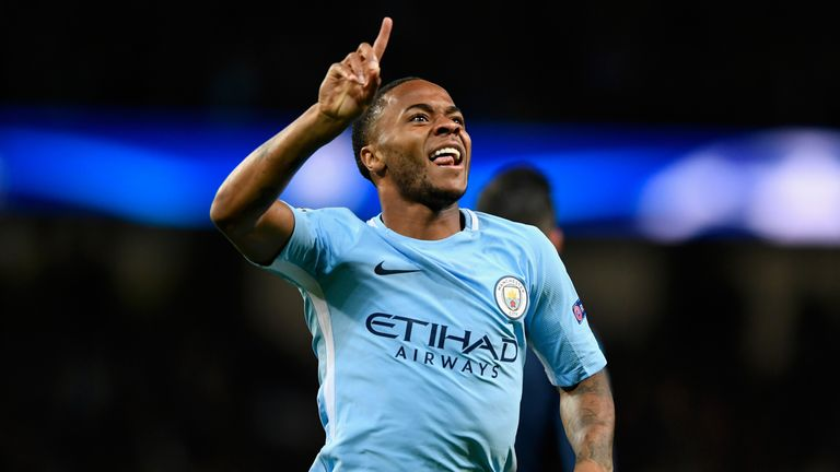 Raheem Sterling celebrates Manchester City's first goal against Napoli