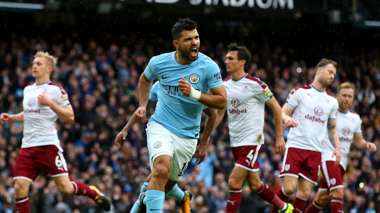 Sergio Aguero of Manchester City celebrates as he scores their first goal from the penalty spot during the Premier League match