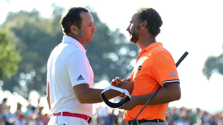 CADIZ, SPAIN - OCTOBER 22:  Sergio Garcia of Spain is congratulated on his victory on the 18th green by Joost Luiten of the Netherlands (R) during the fina