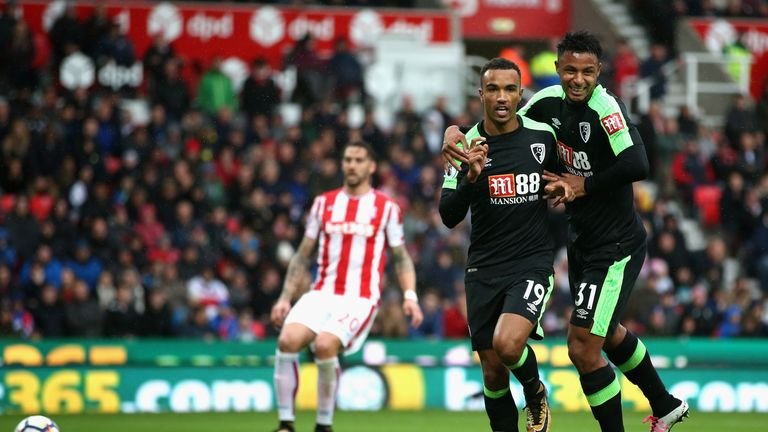 STOKE ON TRENT, ENGLAND - OCTOBER 21:  Junior Stanislas of AFC Bournemouth celebrates scoring the 2nd Bournemouth goal with Lys Mousset of AFC Bournemouth