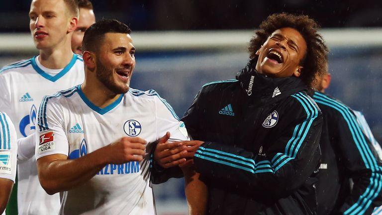 Sead Kolasinac and Leroy Sane share a joke at Schalke in January 2016
