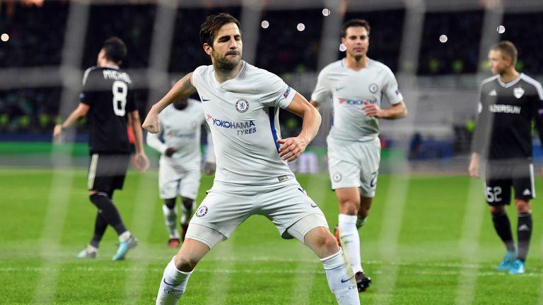 Chelsea midfielder Cesc Fabregas (C) celebrates after scoring from the penalty spot