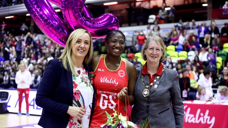 Kadeen Corbin (centre) celebrates her 50th cap with head coach Tracy Neville (left)