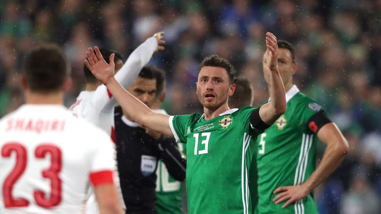 Northern Ireland's Corry Evans reacts after conceding a penalty for handball