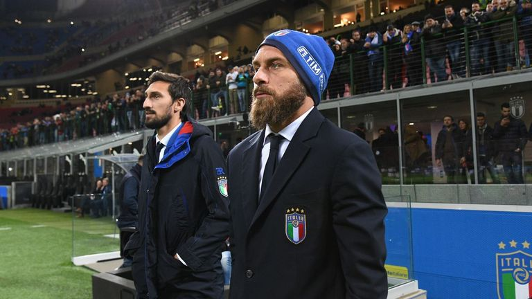 Daniele de Rossi (right) won't be at the World Cup after Italy's elimination