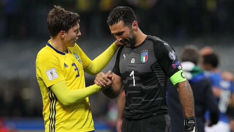 Italy's Gianluigi Buffon (right) is comforted by Sweden and Man Utd's Victor Lindelof