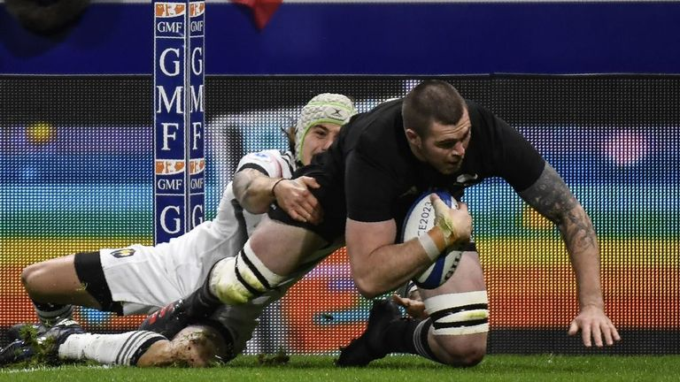 Liam Squire (right) scores his try despite the best intentions of France's right wing Gabriel Lacroix