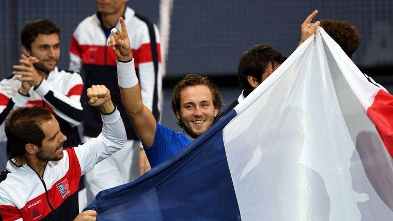France's Lucas Pouille celebrates after winning his decisive singles rubber match