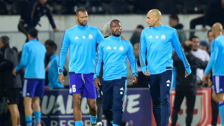 Marseille's Patrice Evra sent off for karate kick on fan