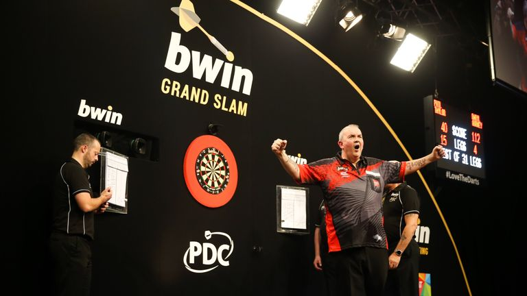 Phil Taylor is into the Grand Slam semi-final and will face Michael van Gerwen