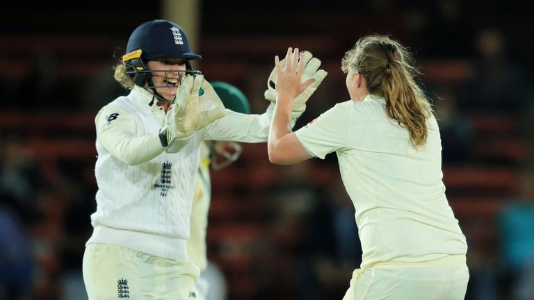 Taylor and Anya Shrubsole celebrate the dismissal of Elyse Villani during the Ashes