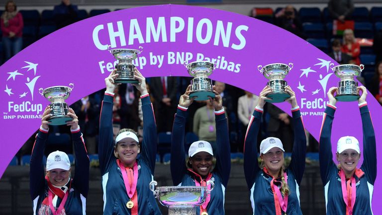 The United States team celebrate after winning the Fed Cup final against Belarus