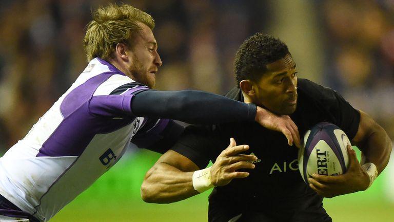 Stuart Hogg tackles Waisake Naholo