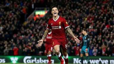 Philippe Coutinho celebrates after scoring Liverpool's third against Southampton